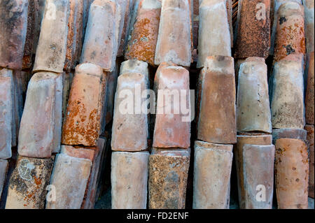 stack of colored rooftiles at a junkyard - Stock Photo
