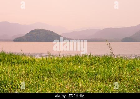 Hazy sunset landscape of Lake de  Yojoa in Honduras - Stock Photo