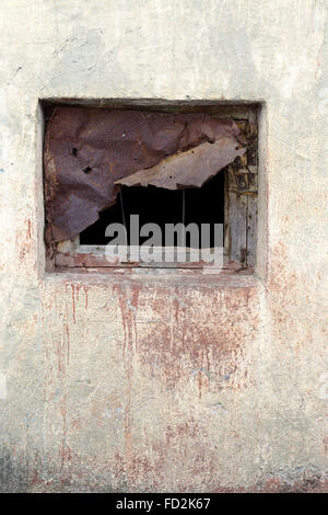 Window scored piece of rusty iron plate on the wall with scratches and cracks. Great background or texture for your - Stock Photo