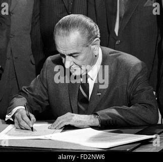 Lyndon B Johnson, the 36th President of the USA, signing the 1968 Civil Rights Act, 11th April 1968. Photo by Warren K Leffler, U.S. News & World Report Magazine.