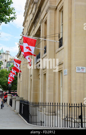 Canada House on Trafalgar Square, London, with maple leaf flags. Embassy of Canada in England. Canadian High Commission - Stock Photo