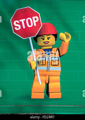 A Lego Poster With A Female Construction Worker Holding A Stop Sign Warning Of No Entry To The Legoland Hotel Construction - Stock Photo