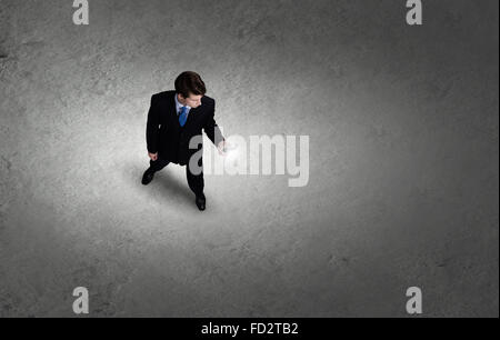 Top view of young businessman using mobile phone - Stock Photo