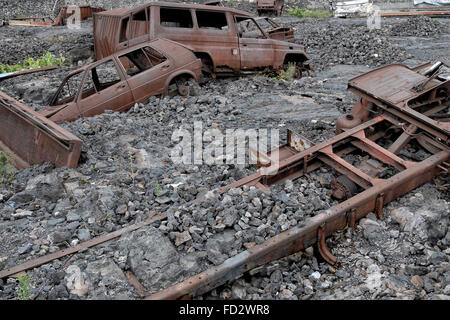 Cars and trucks embedded in dry volcano lava due to 2002 Mount Nyiragongo eruption in the city of Goma. North Kivu - Stock Photo