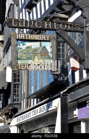 Sign above Hathaway tea rooms in The Shakespeare town of Stratford upon Avon sign illustrates Anne Hathaway's Cottage - Stock Photo