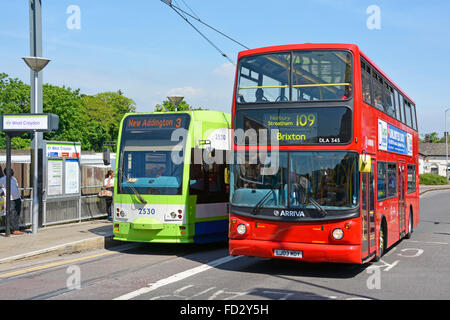 London red double decker Arriva bus route 109 alongside Croydon tram service to New Addington at West Croydon tramlink - Stock Photo