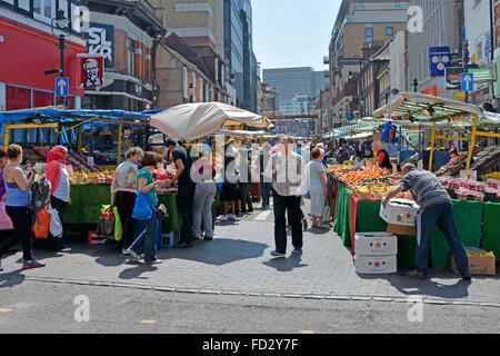 Shoppers and stalls in Surrey Street market Croydon - Stock Photo