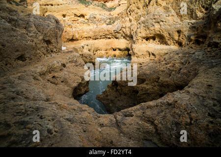 Large rock pool at Algar Seco, near Carvoeiro in the Algarve region of Portugal. - Stock Photo