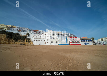 Houses and restaurants on the beach at Carvoeiro in the Algarve region of Portugal. - Stock Photo