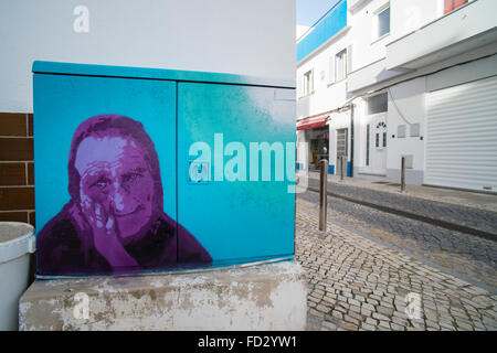 Electricity boxes painted by Bamby and Phil da Bife in the Algarve holiday resort of Carvoeiro - Stock Photo