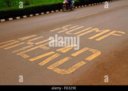 Road warning painted on the ground warning that there is a 'hump ahead' in reference to a speed bump in Kigali, - Stock Photo
