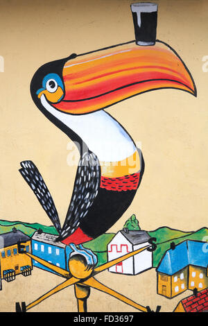 Guinness toucan on the wall of a pub in Clonmany Stock Photo ...