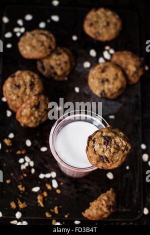 Rich oat cookies with raisin and chocolate chips, having crunchy edges and flavorful chewy center. Set up onto a - Stock Photo