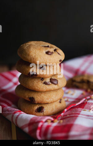 Stack of chocolate chip cookies on a kitchen cloth - Stock Photo