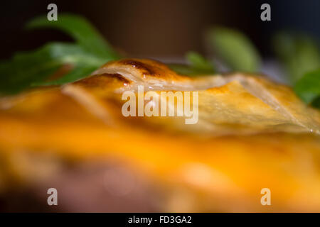Pastry crust on steak and kidney pie. French restaurant prepared cuisine influenced by a traditional English recipe - Stock Photo