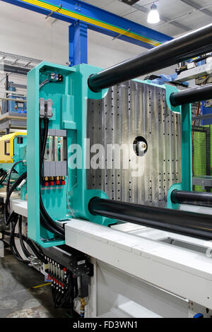 Injection moulding machine used for the forming of plastic parts using plastic resin and polymers. - Stock Photo