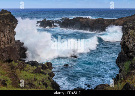 Chile, Easter Island, Rapa Nui National Park, Waves crashing on the rocks - Stock Photo