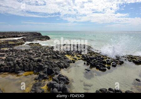 Basalt rock formations on the Back Beach near Wyalup Rocky Point at Bunbury, Western Australia - Stock Photo