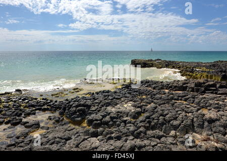 Basalt rock formations on the Back Beach near Wyalup Rocky Point at Bunbury, Western Australia - Stock Photo