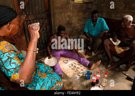 Fortune telling by a Fa in Ouidah - Stock Photo