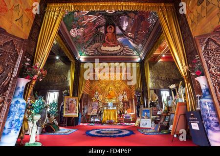 Ornate interior of Wat Buppharam, Chiang Mai, Thailand - Stock Photo