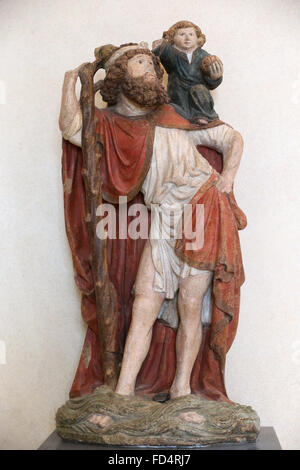 The Louvre Museum. Saint Christopher carrying the Christ Child. 15th Century. - Stock Photo