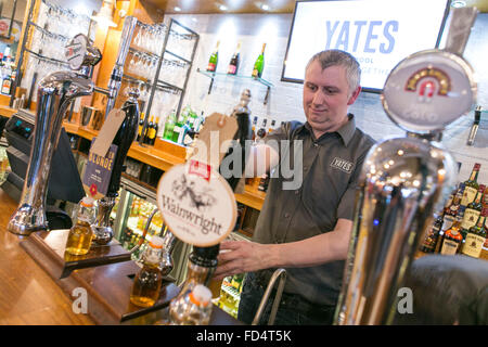 draught real ales for sale in a Yates Pub - Stock Photo