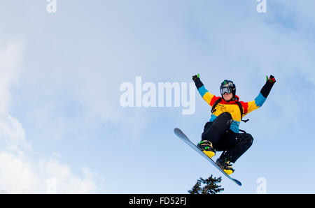Braunlage, Germany. 28th Jan, 2016. A young man practices his skills on his snowboard on a slope of the Wurmberg - Stock Photo