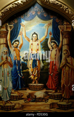 Painting in the London ISKCON hindu temple : Panchat Tattva, the 5 tattva :  Chatanya in the middle surrounded by - Stock Photo