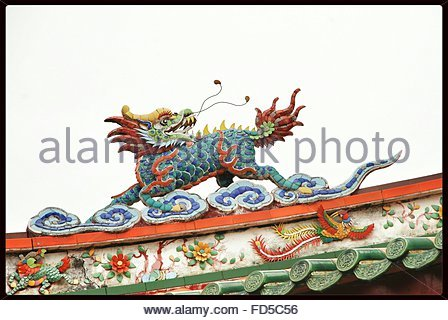 Chinese Dragon Statue On Top Of Temple Against Clear Sky - Stock Photo