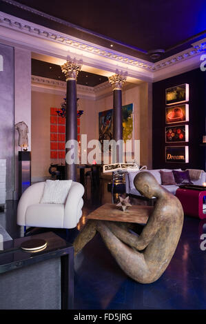 Collection of contemporary art pieces on display in London apartment - Stock Photo