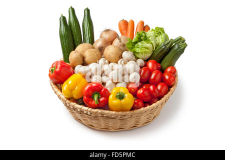 Basket with fresh vegetables on white background - Stock Photo