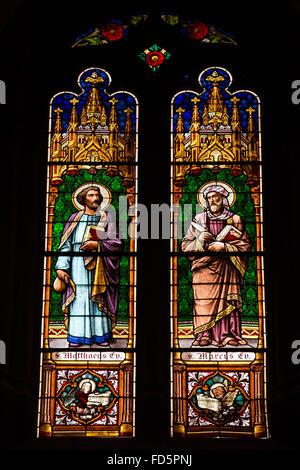Stained glass windows depicting St Matthew and St Mark in San Cristóbal de La Laguna on Tenerife, Spain. - Stock Photo