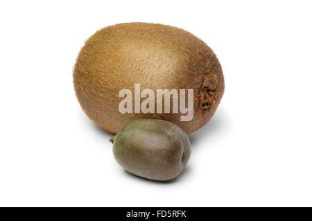 Whole kiwi fruit and kiwi berry on white background - Stock Photo