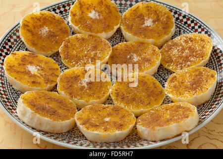 Traditional Moroccan orange slices with sugar and cinnamon as dessert - Stock Photo