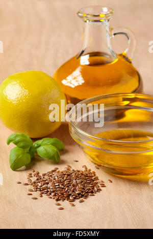 Bottle of flax seed oil ready to use for a dressing - Stock Photo