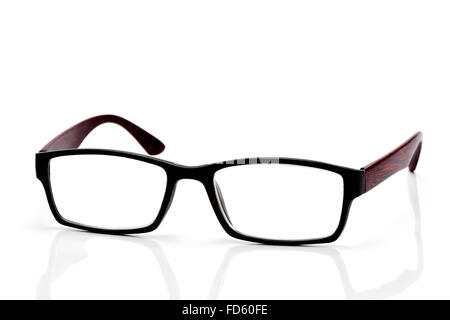 closeup of a pair of plastic and wooden rimmed eyeglasses on a white background - Stock Photo