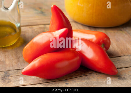 Whole fresh Cornue des Andes tomatoes - Stock Photo