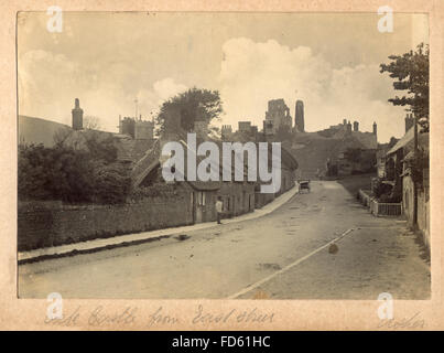 Victorian photograph of Corfe Castle from East Street. c 1900. Corfe Castle is a fortification standing above the village of the same name on the Isle of Purbeck in the English county of Dorset.