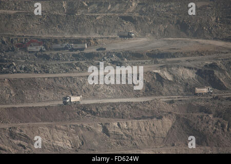 Trucks At Layers Of Opencast Mine - Stock Photo