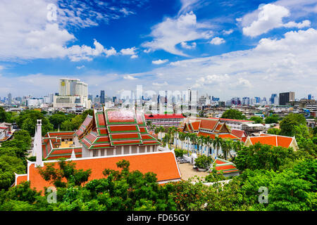 Bangkok, Thailand skyline over Wat Saket Temple buildings. - Stock Photo