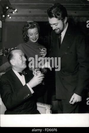 1958 - Noel Coward the famous English author and playwright (seated), has some champagne which the French actor - Stock Photo