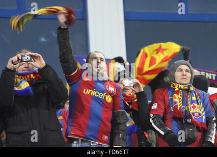 FC Barcelona fans celebrate after scoring against FC Dynamo Kiev during their UEFA Champions League football match - Stock Photo
