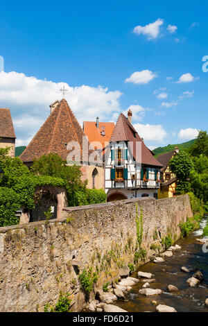 Houses bordering the Weiss river kaysersberg, wine route, Alsace Haut Rhin France - Stock Photo