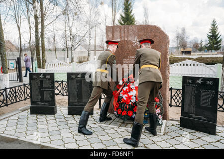 Cadets Ministry of Emergency Situations laying of wreaths at mass grave of Soviet soldiers who died during battles - Stock Photo