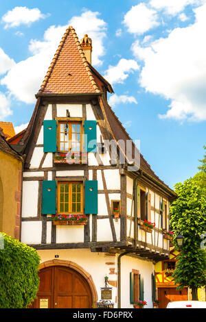 Half timbered houses bordering the Weiss river kaysersberg, wine route, Alsace Haut Rhin France - Stock Photo