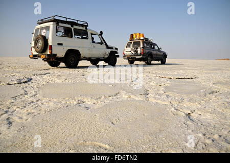 Two Toyota off-road vehicles on Lake Assale in the Danakil depression, Afar Region, Ethiopia - Stock Photo