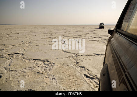 Two off-road vehicles on Lake Assale in the Danakil depression, Afar Region, Ethiopia - Stock Photo