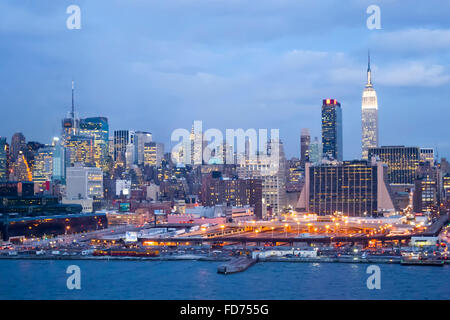 The panorama of Midtown Manhattan coast viewed from the Hudson River at sunset in New York City, USA. - Stock Photo