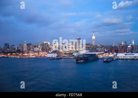 The panorama of Midtown Manhattan coast viewed from the Hudson River at night in New York City, USA. - Stock Photo